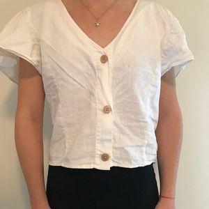 White, slightly cropped blouse